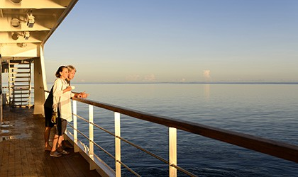 A couple enjoying time at sea from the Xplorer Deck